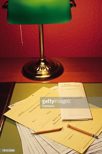 Legal documents on desk with lamp and broken pencil