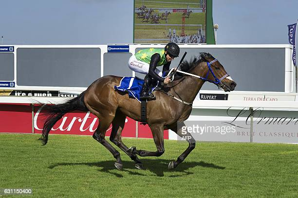 Legal Eagle, ridden by jockey Anton Marcus, wins the L'Ormarins Queen's Plate horse racing event, a combination of horse racing and elegant attire,...