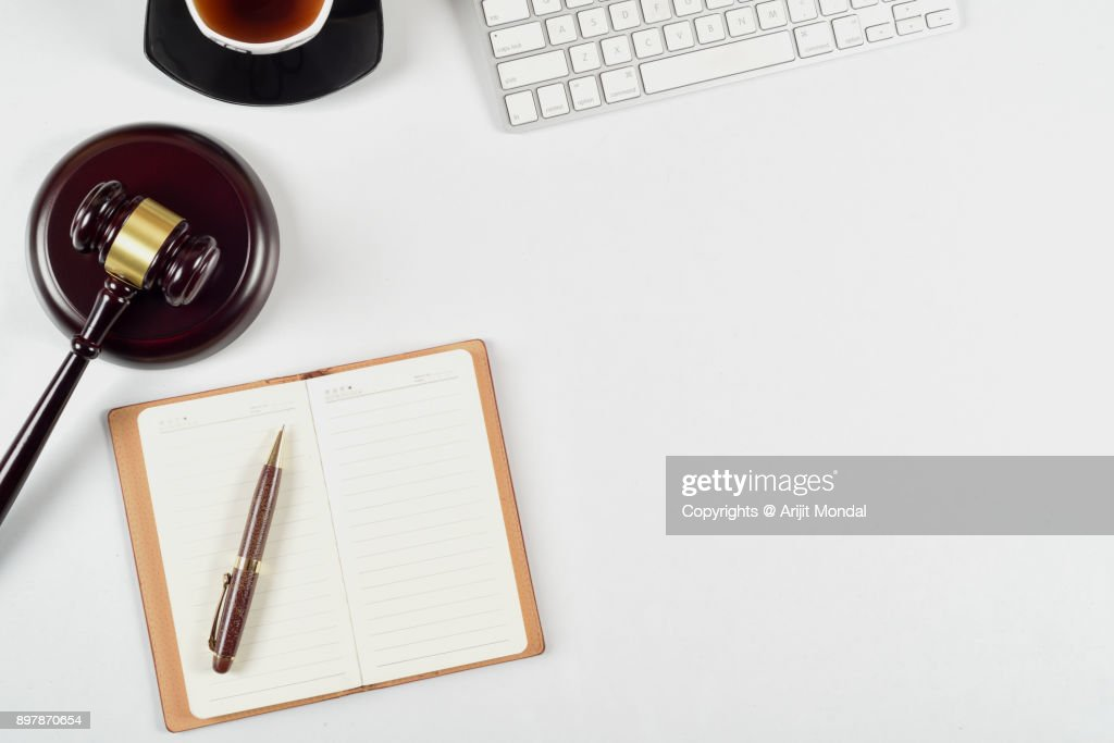 Legal office table top view with gravel, black tea with cup, pen, computer keyboard and notebook : Stock Photo