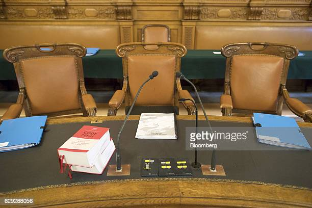 Legal reference books sit on desks at the seating area for judges and lawmakers conducting the trial of Christine Lagarde managing director of the...