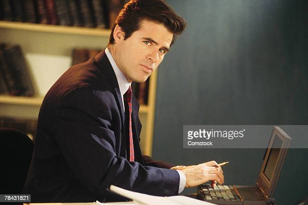 legal researcher typing on laptop computer - 1990 1999 photos et images de collection