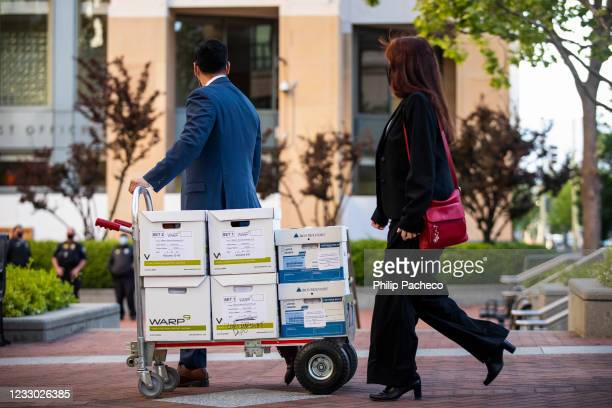 Legal staff representing Apple push a cart of documents for trial at the United States District Court on May 21, 2021 in Oakland, California. Epic...