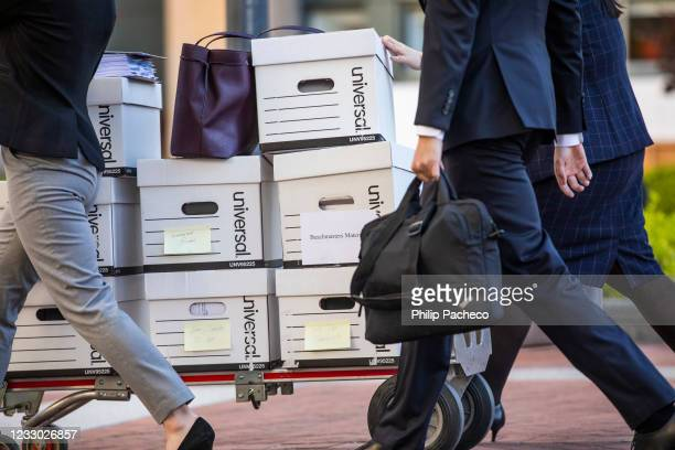 Legal staff representing Epic Games push a cart of documents for trial at the United States District Court on May 21, 2021 in Oakland, California....