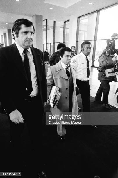 Legal teams walk to the courtroom for John Wayne Gacy's arraignment at the Criminal Courts Building 2650 South California Avenue Chicago Illinois...