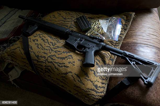 A legally purchased and owned AR15 Bushmaster assault rifle lies on a living room couch in a private home in Maryland September 18 2016 H