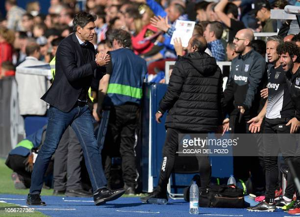 Leganes' Argentinian coach Mauricio Pellegrino celebrates the equalizer during the Spanish league football match between Club Deportivo Leganes SAD...