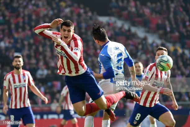 Leganes' Argentinian defender Jonathan Silva and Atletico Madrid's Spanish forward Alvaro Morata jump for the ball during the Spanish league football...