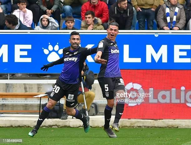 Leganes' Argentinian defender Jonathan Silva celebrates with Leganes' Uruguayan forward Michael Santos after scoring during the Spanish league...