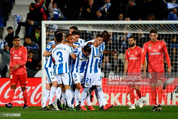 Leganes' Argentinian defender Jonathan Silva celebrates with teammates after scoring during the Spanish league football match between Club Deportivo...