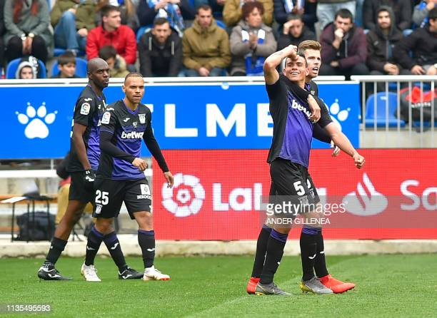 Leganes' Argentinian defender Jonathan Silva celebrates with teammtes after scoring during the Spanish league football match between Deportivo Alaves...