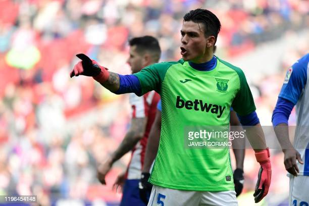 Leganes' Argentinian defender Jonathan Silva wears the goalkeeper jersey during the Spanish league football match Club Atletico de Madrid against...
