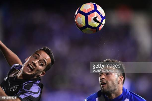 Leganes' defender Diego Rico vies with Real Madrid's midfielder Lucas Vazquez during the Spanish league football match Club Deportivo Leganes SAD vs...