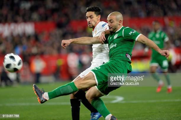 Leganes' Dutch forward Nordin Amrabat vies with Sevilla's Spanish midfielder Jesus Navas during the Spanish 'Copa del Rey' second leg semifinal...