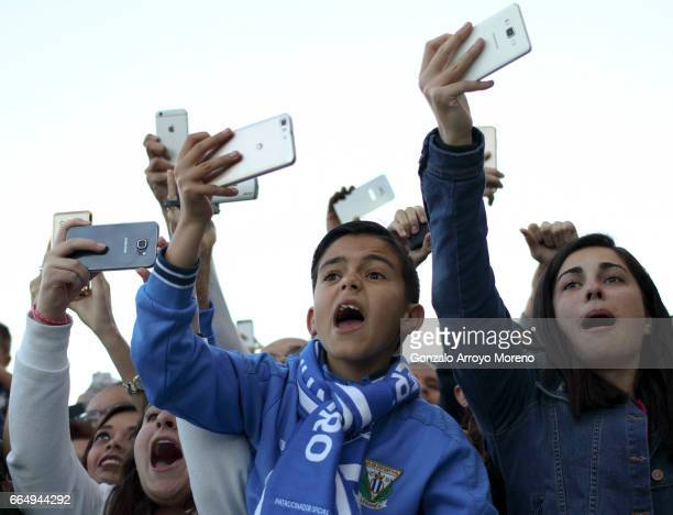 Leganes fans cheer their team at Estadio Municipal de Butarque outdoors before the La Liga match between CD Leganes and Real Madrid CF on April 5...
