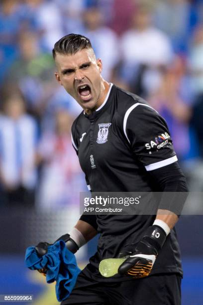 Leganes' goalkeeper from Spain Ivan Cuellar Sacristan reacts after the Spanish league football match Club Deportivo Leganes SAD vs Club Atletico de...