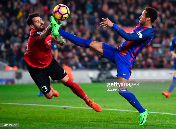 Leganes' goalkeeper Iago Herrerin vies with Barcelona's Brazilian forward Neymar during the Spanish league football match FC Barcelona vs CD Leganes...