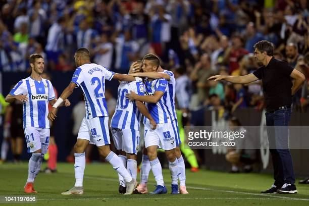 Leganes' Moroccan forward Nabil El Zhar celebrates his goal with teammates during the Spanish league football match Club Deportivo Leganes SAD...