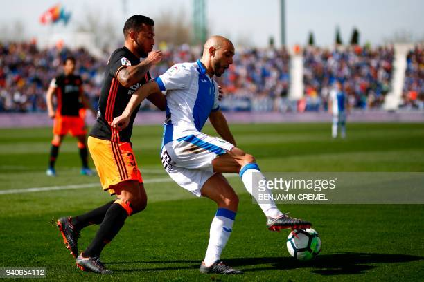 Leganes' Moroccan forward Nordin Amrabat challenges Valencia's Portuguese defender Ruben Vezo during the Spanish League football match between...