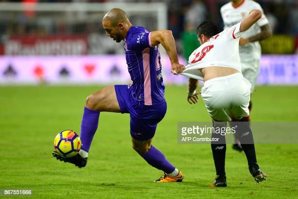 Leganes' Moroccan forward Nordin Amrabat vies with Sevilla's defender Sergio Escudero during the Spanish league footbal match Sevilla FC vs Club...