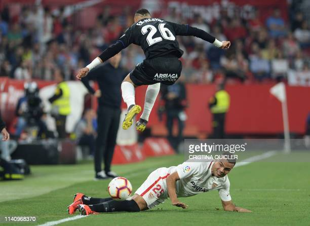 Leganes' Moroccan forward Youssef EnNesyri jumps over Sevilla's Argentinian defender Gabriel Mercado during the Spanish league football match between...