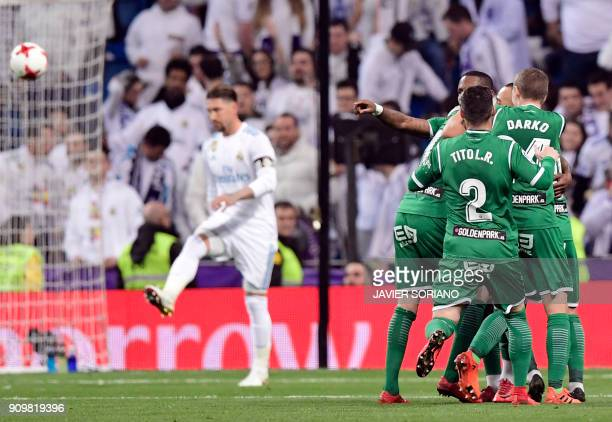 Leganes players celebrate a goal during the Spanish 'Copa del Rey' quarterfinal second leg football match between Real Madrid CF and CD Leganes at...