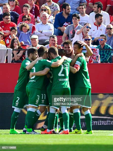 Leganes' players celebrate after Legane's Brazilian midfielder Gabriel Appelt scored during the Spanish league football match Sevilla FC vs Club...