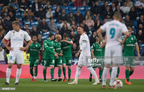 Leganes players celebrate after scoring their opening goal during the Copa del Rey Quarter Final Second Leg match between Real Madrid and Leganes at...