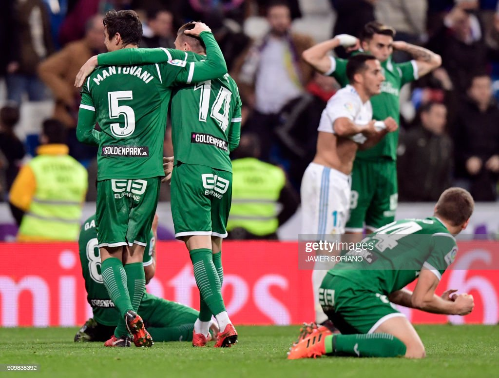 Leganes players celebrate their qualification for semifinals at the end of the Spanish 'Copa del Rey' (King's cup) quarter-final second leg football match between Real Madrid CF and CD Leganes at the Santiago Bernabeu stadium in Madrid on January 24, 2018. /