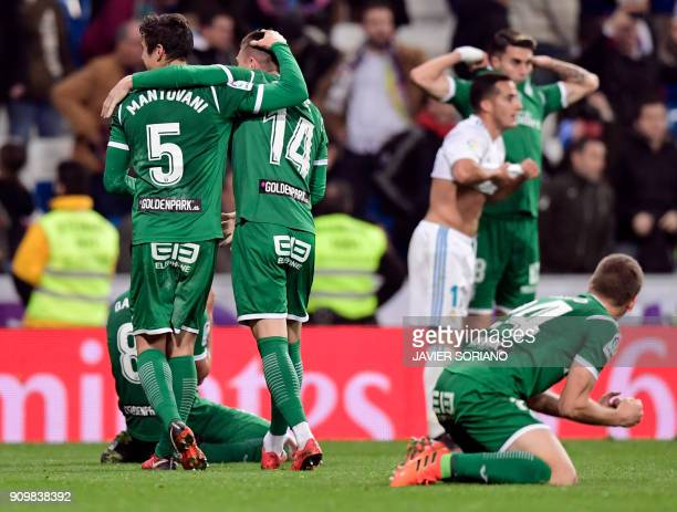 Leganes players celebrate their qualification for semifinals at the end of the Spanish 'Copa del Rey' quarterfinal second leg football match between...