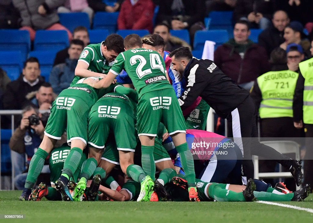 Leganes players celebrate their second goal during the Spanish 'Copa del Rey' (King's cup) quarter-final second leg football match between Real Madrid CF and CD Leganes at the Santiago Bernabeu stadium in Madrid on January 24, 2018. /