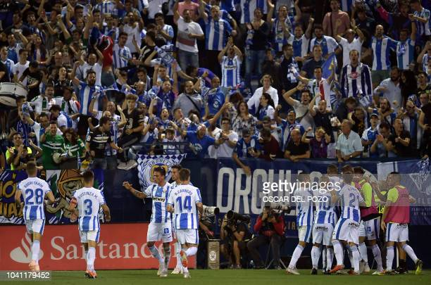 Leganes players celebrate their second goal during the Spanish league football match Club Deportivo Leganes SAD against FC Barcelona at the Estadio...