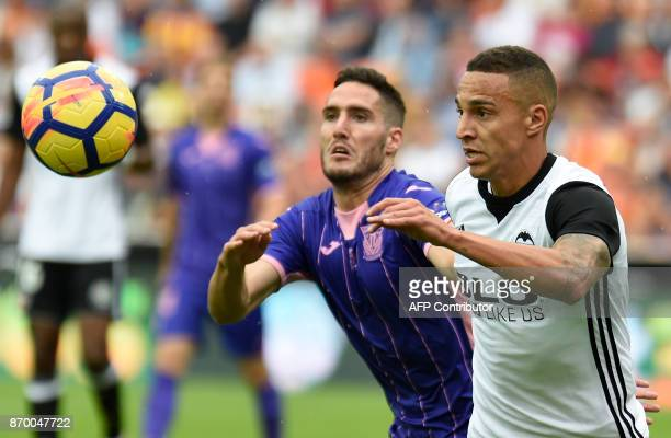 Leganes' Spanish defender Joseba Zaldua vies with Valencia's Brazilian forward Rodrigo Moreno during the Spanish league footbal match Valencia CF vs...