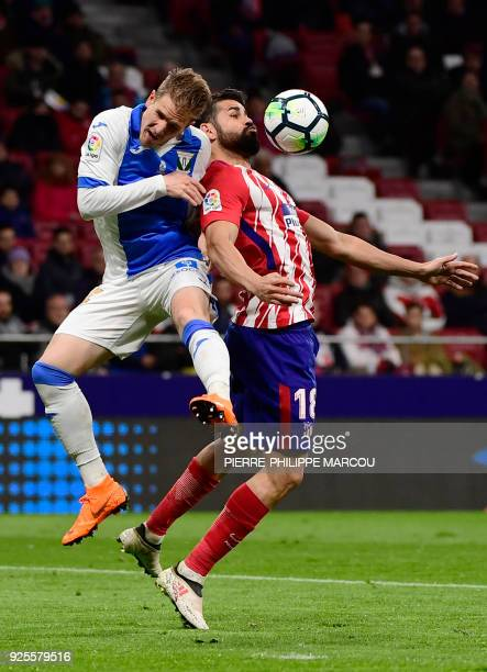 Leganes' Spanish defender Raul Garcia vies with Atletico Madrid's Spanish forward Diego Costa during the Spanish league football match Club Atletico...