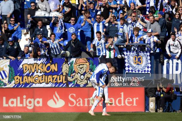 Leganes' Spanish defender Rodrigo Tarin celebrates after scoring the equalizer during the Spanish league football match between Club Deportivo...