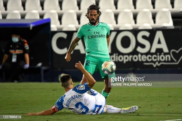 Leganes' Spanish defender Unai Bustinza challenges Real Madrid's Spanish midfielder Isco during the Spanish league football match Club Deportivo...
