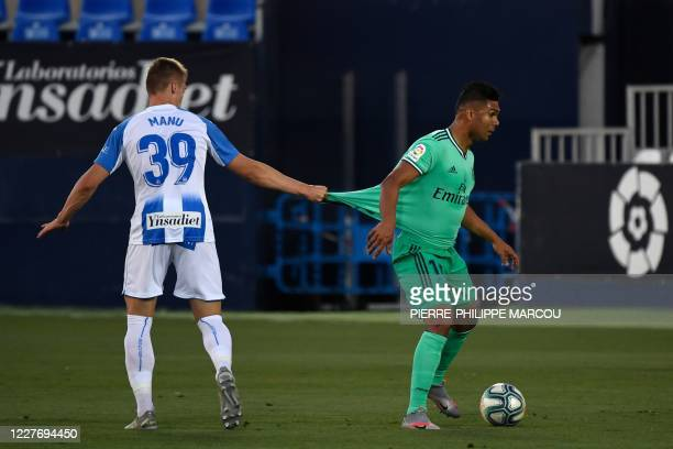 Leganes´ Spanish forward Manuel Garrido challenges Real Madrid's Brazilian midfielder Casemiro during the Spanish league football match Club...