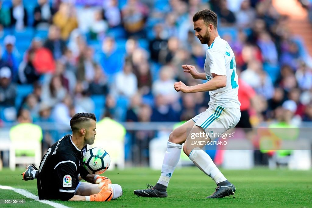 Leganes' Spanish goalkeeper Pichu Cuellar blocks a shot on goal by Real Madrid's Spanish forward Borja Mayoral (R) during the Spanish League football match between Real Madrid and Leganes at the Santiago Bernabeu Stadium in Madrid on April 28, 2018.