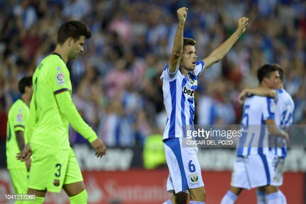 Leganes' Spanish midfielder Gerard Gumbau celebrates their win at the end of the Spanish league football match Club Deportivo Leganes SAD against FC...