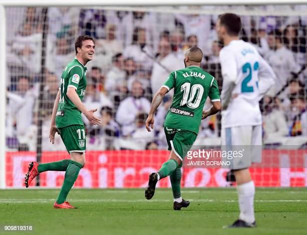 Leganes' Spanish midfielder Javier Eraso celebrates a gola during the Spanish 'Copa del Rey' quarterfinal second leg football match between Real...