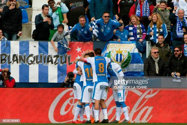 Leganes' Spanish midfielder Javier Eraso celebrates with teammates after scoring during the Spanish League football match between Club Deportivo...