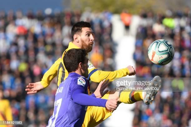 Leganes' Spanish midfielder Javier Eraso challenges Barcelona's Argentine forward Lionel Messi during the Spanish league football match Club...
