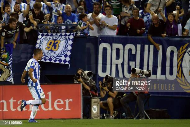 Leganes' Spanish midfielder Oscar Rodriguez celebrates his team's second goal during the Spanish league football match Club Deportivo Leganes SAD...