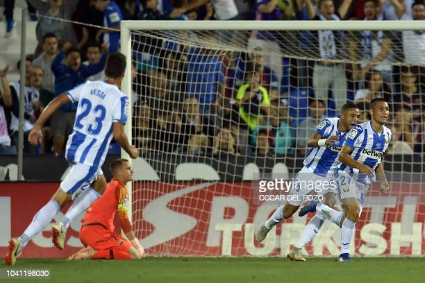 Leganes' Spanish midfielder Oscar Rodriguez celebrates his team's second goal during the Spanish league football match Club Deportivo Leganes SAD...
