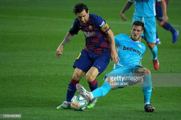 Leganes' Spanish midfielder Ruben Perez challenges Barcelona's Argentine forward Lionel Messi during the Spanish league football match FC Barcelona...