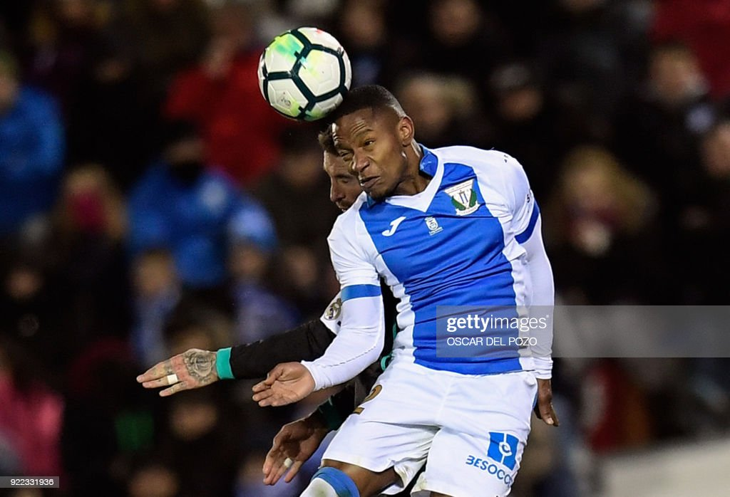 Leganes's Guadaleupean forward Claudio Beauvue heads the ball during the Spanish league football match Club Deportivo Leganes SAD against Real Madrid CF at the Estadio Municipal Butarque in Leganes on the outskirts of Madrid on February 21, 2018. /