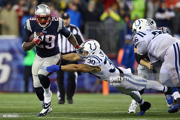 LeGarrette Blount of the New England Patriots breaks a tackle by LaRon Landry of the Indianapolis Colts to score a touchdown in the fourth quarter...