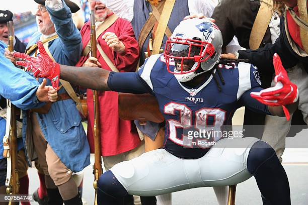 LeGarrette Blount of the New England Patriots celebrates scoring a touchdown during the third quarter against the Miami Dolphins at Gillette Stadium...