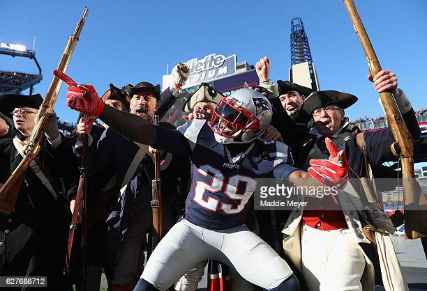 LeGarrette Blount of the New England Patriots celebrates scoring a touchdown during the first quarter against the Los Angeles Rams at Gillette...
