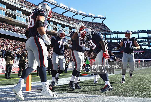 LeGarrette Blount of the New England Patriots celebrates with teammates after scoring a touchdown during the first quarter against the Los Angeles...