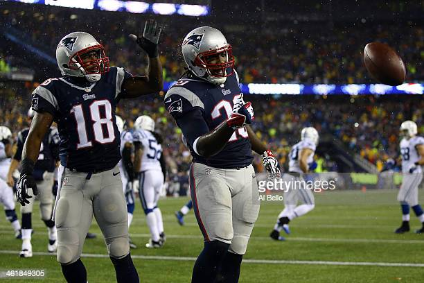 LeGarrette Blount of the New England Patriots celebrates with teammate Matthew Slater in the end zone after scoring a 2 yard touchdown in the first...